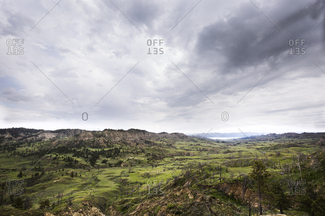 Darks clouds gathering over lush green valley floor