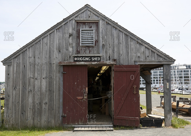 Old weather beaten wooden shed in marina in Boston