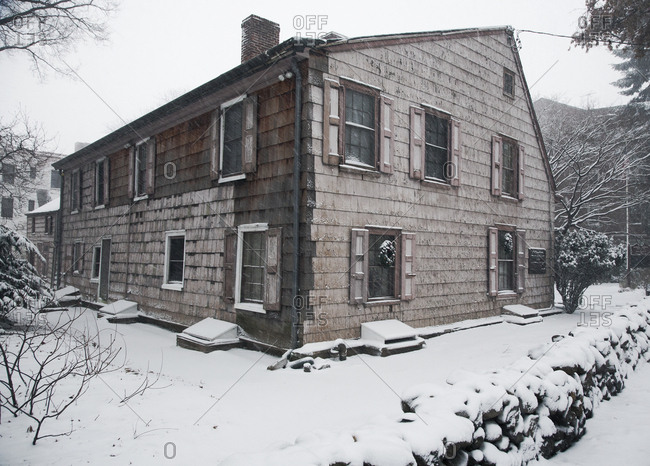 Historic old house blanketed in snow