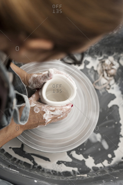 High angle view of woman making pottery