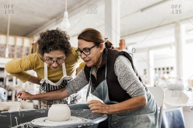 Two women making pottery