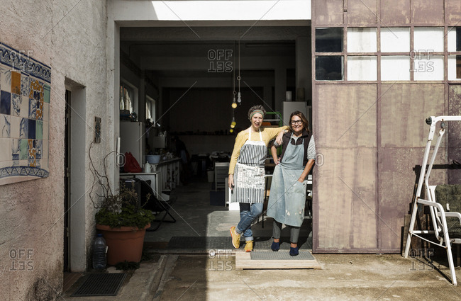 Portrait of two female potters in workshop