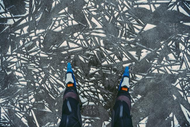 Low section of man wearing ice skates