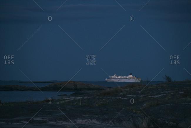Passenger ship on ocean at dusk
