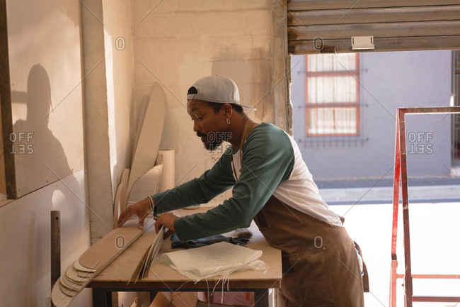 Man making skateboard in workshop