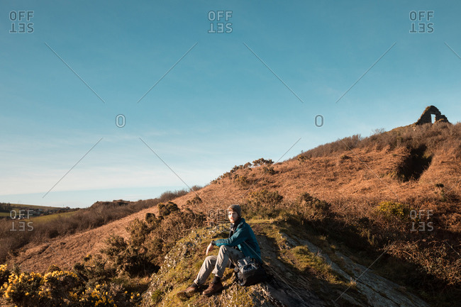 Male hiker relaxing at countryside on a sunny day