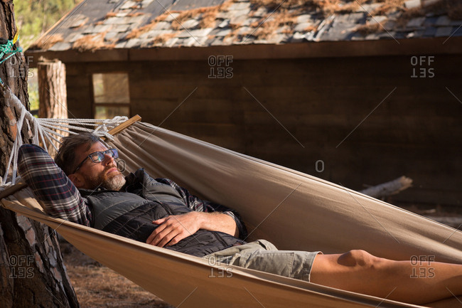 Man relaxing in hammock on a sunny day