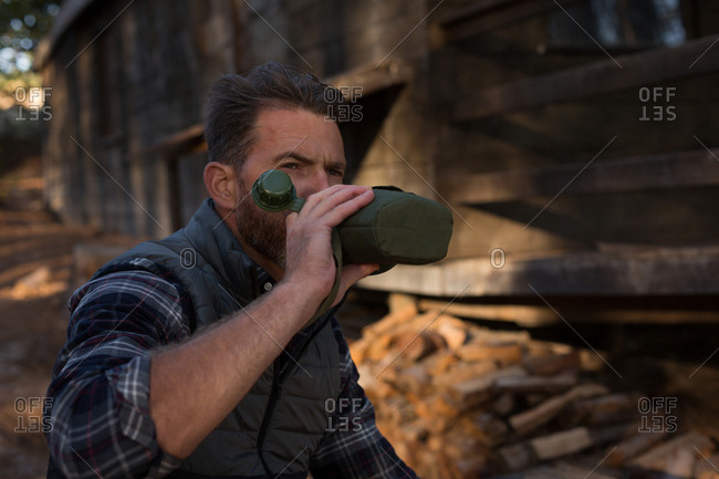 Man drinking water from bottle on a sunny day