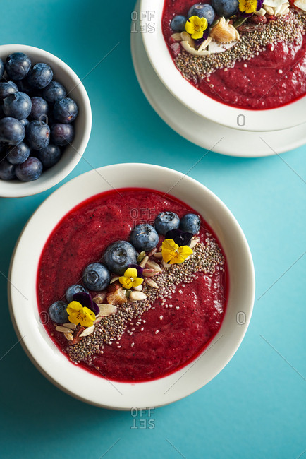 Smoothie bowls on a blue background