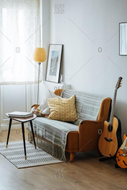 Stylish furniture arrangement in sunlit living room