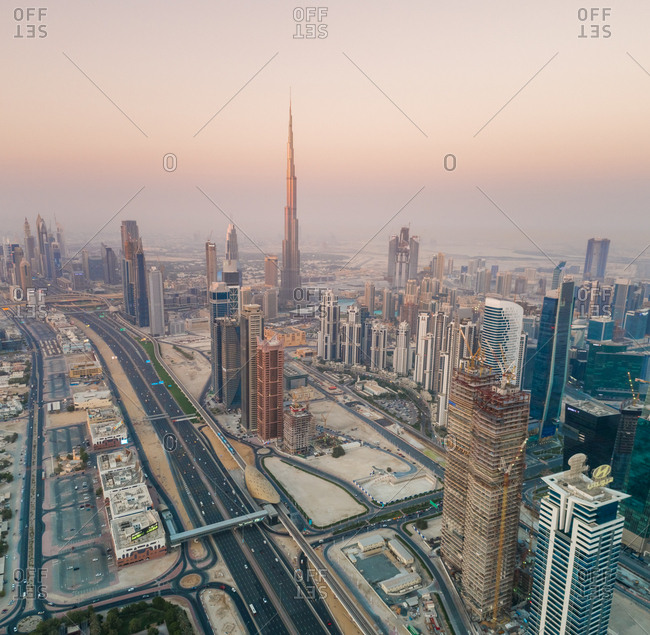 Dubai, United Arab Emirates - June 17, 2017: Aerial view of Burj Khalifa Tower surrounded by others skyscrapers at sunset