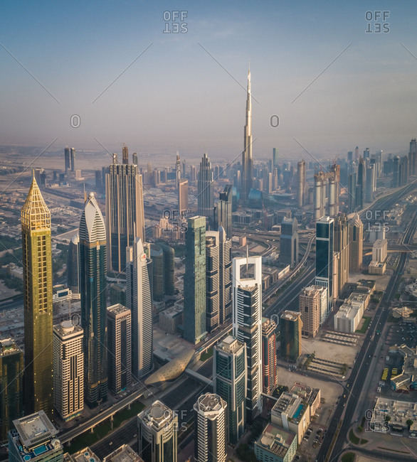 Dubai, United Arab Emirates - June 25, 2017: Aerial view of the impressive Burj Khalifa Tower in the middle of others skyscrapers at sunset