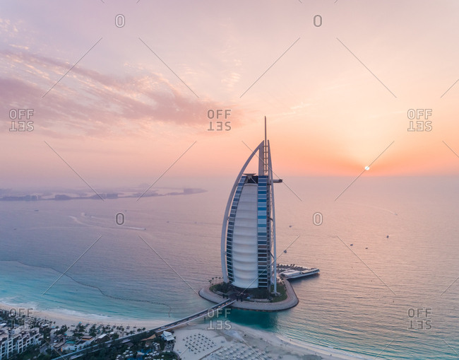 Dubai, United Arab Emirates - June 25, 2017: Aerial view of the luxurious Burj Al Arab Hotel at sunset