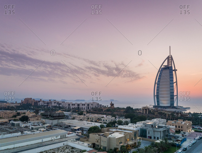 Dubai, United Arab Emirates - June 25, 2017: Aerial view of the luxurious Burj Al Arab Hotel and houses in the suburb