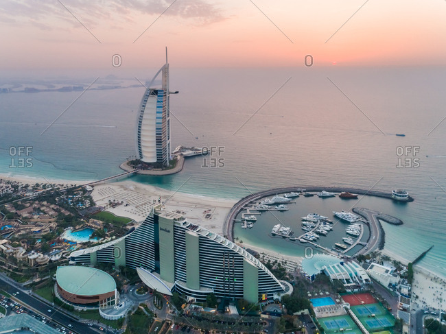 Dubai, United Arab Emirates - June 25, 2017: Aerial view of the luxurious Burj Al Arab Hotel and harbor at sunset on Dubai coast