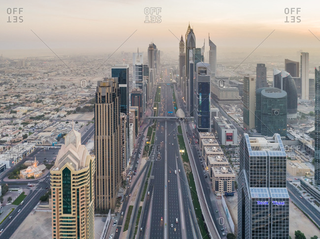 Dubai, United Arab Emirates - July 1, 2017: Aerial view of the traffic lanes and Skyscrapers at sunset