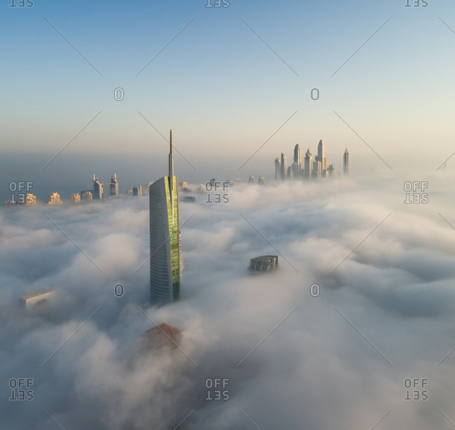 Dubai, United Arab Emirates - September 28, 2017: Aerial view of skyscrapers in the clouds