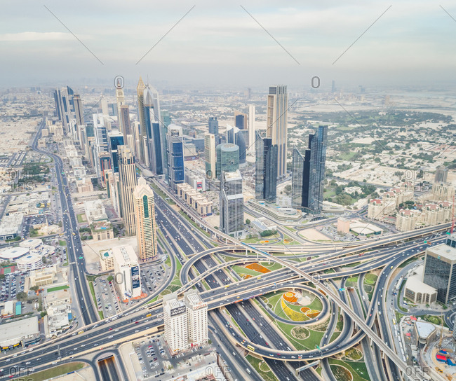 Dubai, United Arab Emirates - November 21, 2017: Aerial view of the traffic lanes and Skyscrapers