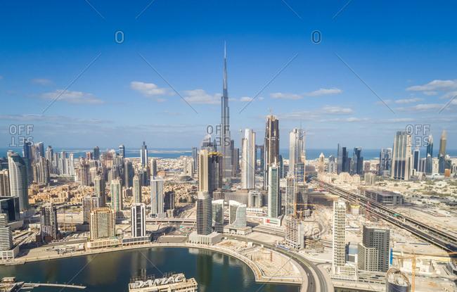 Dubai, United Arab Emirates - November 26, 2017: Aerial view of Dubai creek and Burj Khalifa Tower in background