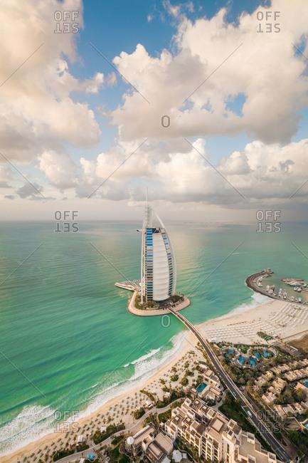 Dubai, United Arab Emirates - January 8, 2018: Panoramic aerial view of the luxurious Burj Al Arab Hotel in the bay