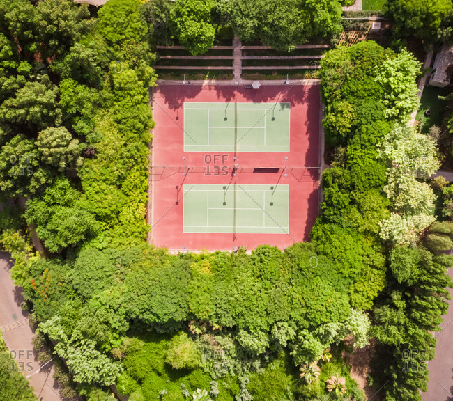 Aerial view of tennis courts in the middle of dense vegetation in Dubai, U.A.E.