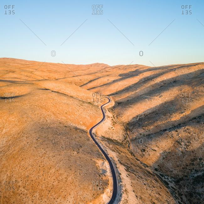 Aerial view of an empty road in Ras Baalbek semi-desert in Lebanon
