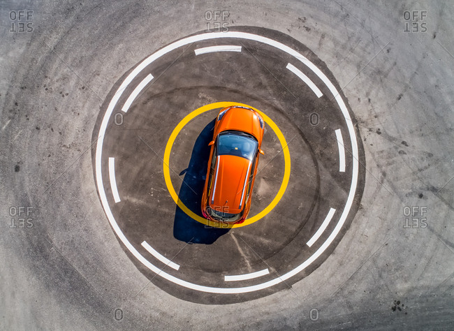 Aerial view of a car parked in the middle of an helipad in Dubai, U.A.E.
