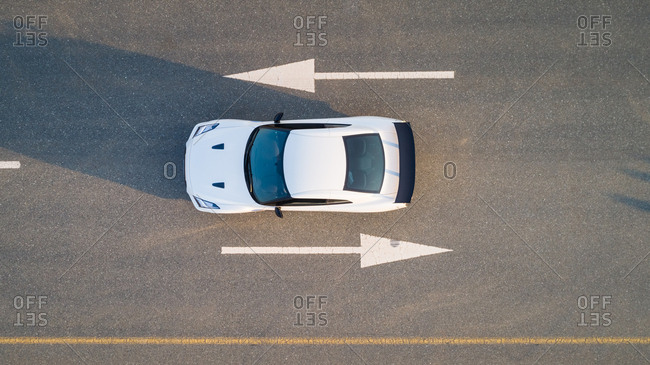 Aerial view of a car on road with arrow signs in Dubai, U.A.E.