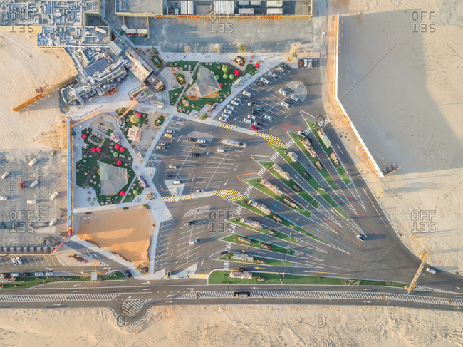 Aerial view of a geometrical parking area in desert of Dubai, U.A.E.