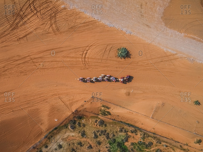 Aerial view of a camel race competition in the desert of Ras Al Khaimah, U.A.E.