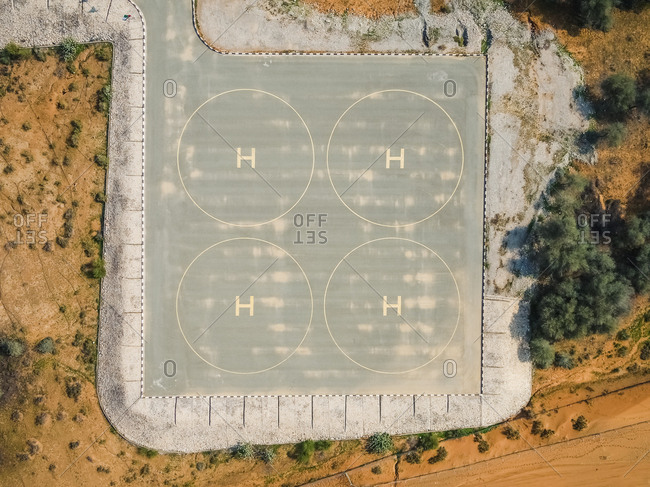Aerial view of a four helipad in the desert of Ras Al Khaimah, U.A.E.