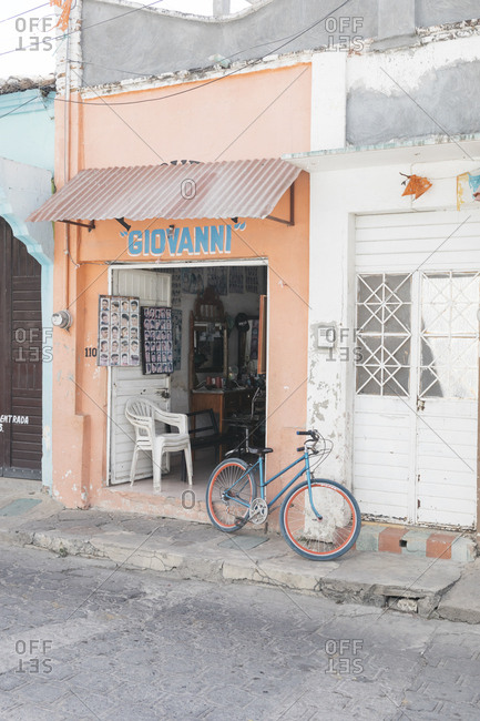 Chiapa de Corzo, Mexico - January 14, 2018: Bicycle parked outside of open storefront