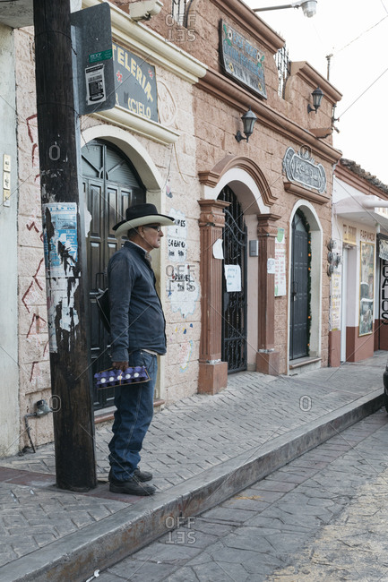 Chiapa de Corzo, Mexico - January 15, 2018: Man wearing cowboy hat waiting to cross street