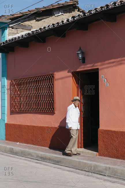 Chiapa de Corzo, Mexico - January 17, 2018: Male senior citizen standing in doorway facing bright sunlight