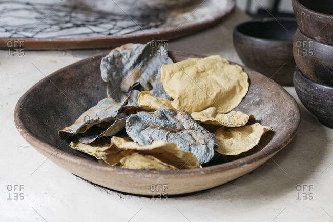 Wooden bowl of crispy tortilla chips on restaurant table