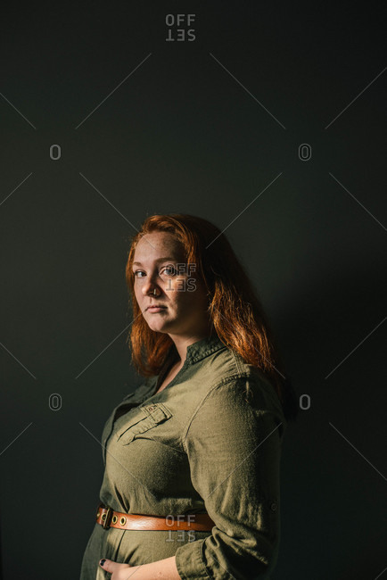 Red-headed woman with nose ring