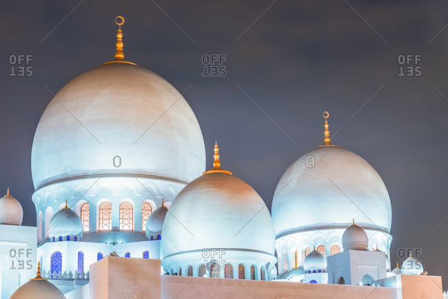 Abu Dhabi, United Arab Emirates - December 27, 2017: Detail of the domed roof of Sheikh Zayed Grand Mosque at twilight