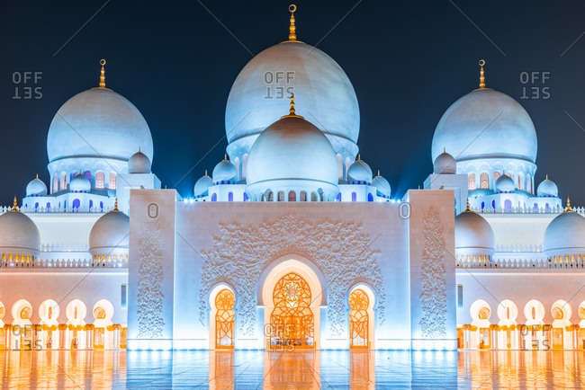 Abu Dhabi, United Arab Emirates - December 27, 2017: Front view of Sheikh Zayed Grand Mosque in Abu Dhabi at twilight
