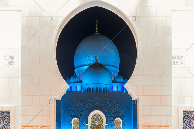 Abu Dhabi, United Arab Emirates - December 27, 2017: Detail of the domed roof o Sheikh Zayed Grand Mosque in the night