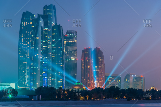 Abu Dhabi, United Arab Emirates - December 28, 2017: Night view of Etihad Towers and Bab al Qasr Hotel on the Corniche