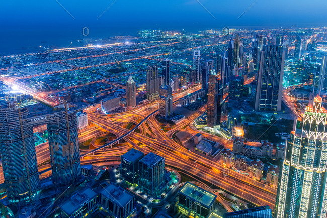 Dubai, United Arab Emirates - December 30, 2017: View from the top panoramic platform on Burj Khalifa across Sheikh Zayed Road in the night