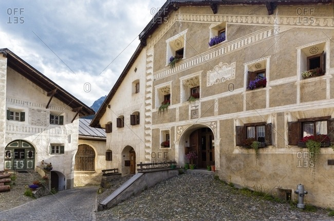 Scuol, Engadine, Canton of Grisons, Switzerland, Europe - July 26, 2013: Old house in Guarda a typical village with houses ornamented with old painted stone 17th Century buildings