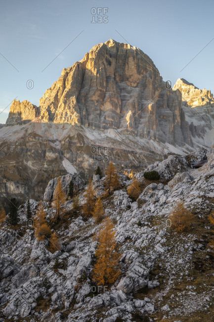 The Tofana di Rozes illuminated by the last light of an autumn afternoon, Dolomites, Cortina d'Ampezzo, Italy