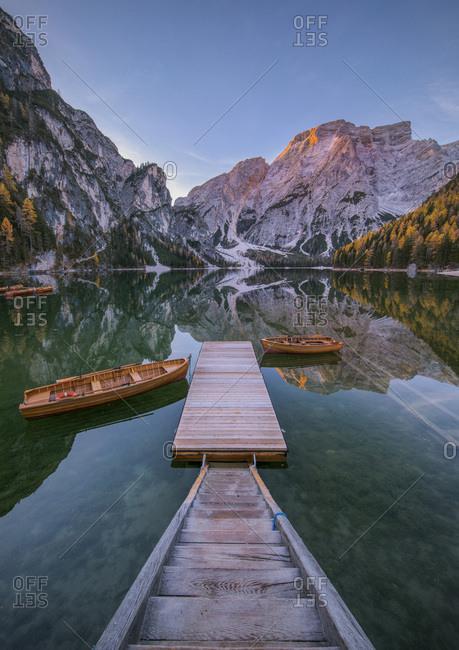 Autumn sunrise on the Braies lake, Dolomites, Pusteria Valley, Italy