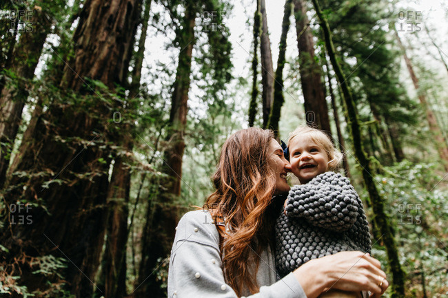 Mother and daughter in redwoods