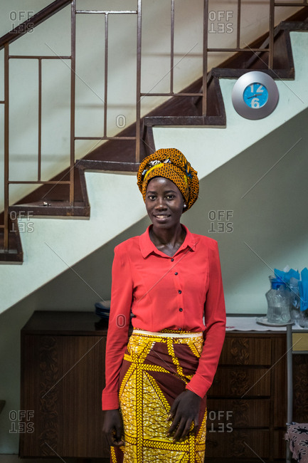 Angola, Africa - April 5, 2018: Adult black woman with yellow headdress