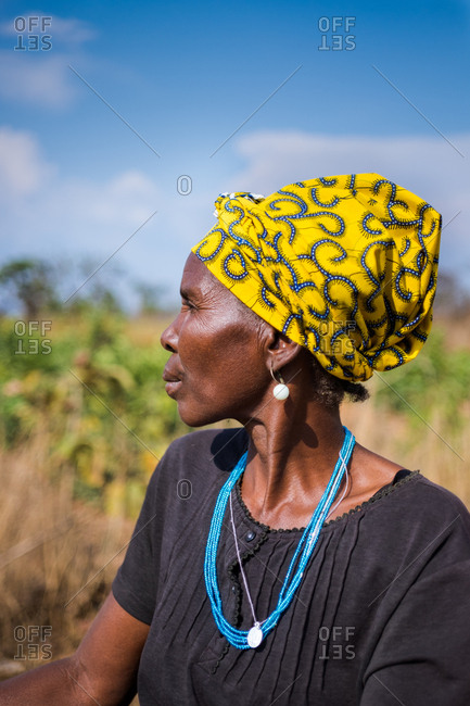 Angola, Africa - April 5, 2018: Adult black woman looking away in nature in sunny day