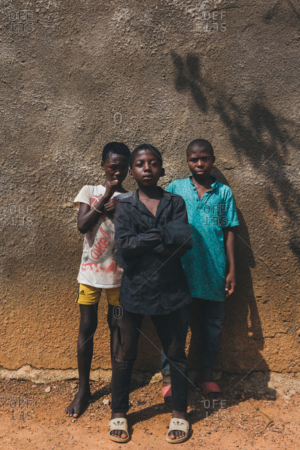 Cameroon, Africa - April 5, 2018: Ethnic boys at wall