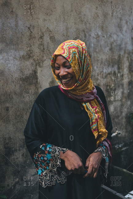 Cameroon, Africa - April 5, 2018: Cheerful ethnic woman in bright headdress