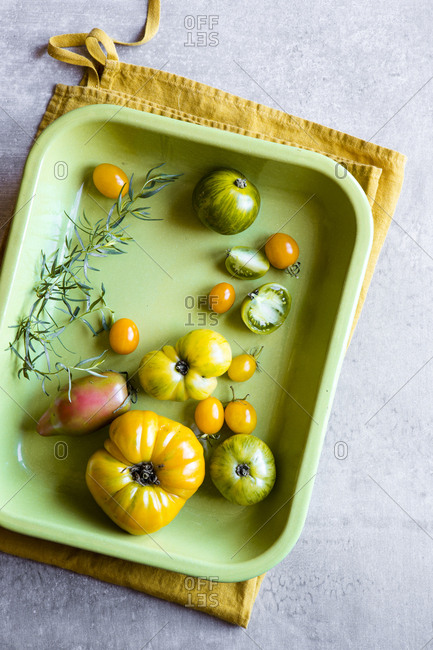 Heirloom tomatoes on a green dish